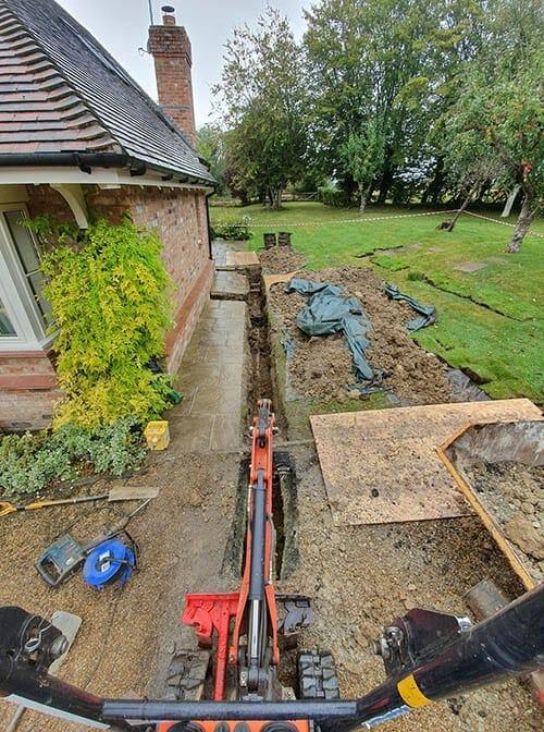 drain repairs epsom